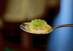 Braised duck ravioli topped with whipped mascarpone, tomato, hazelnut and olive oil.